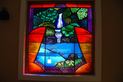 Stained-glass window in hall of the Whetstone Studios by Ric Neumann and Liza King.