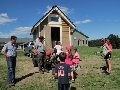 Hilltop Montessori students check out a tiny house that the school raffled as a fundraiser.