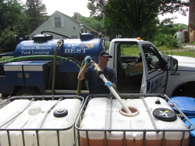 Seth True of Best Septic Service, LLC, pumps urine from a 275-gallon tank for transfer to the farm. A family of three can produce this much urine in eight months.