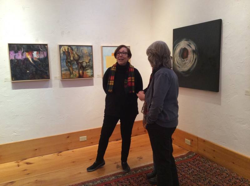 Bobbe Ragouzeos, President of the Board of Trustees, and Marilyn Allen at Marilyn and Nan Heminway's exhibition in the Moore Free Library in Newfane.