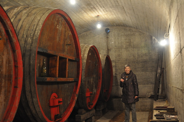 Nicole Chanrion in her cellar next to the large foudres