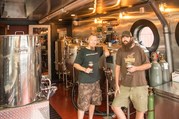 Tim Brady and David Hiler operate Whetstone Station Restaurant and Brewery in Brattleboro. Here Brady is pictured with his assistant brewer, Connor Busch.