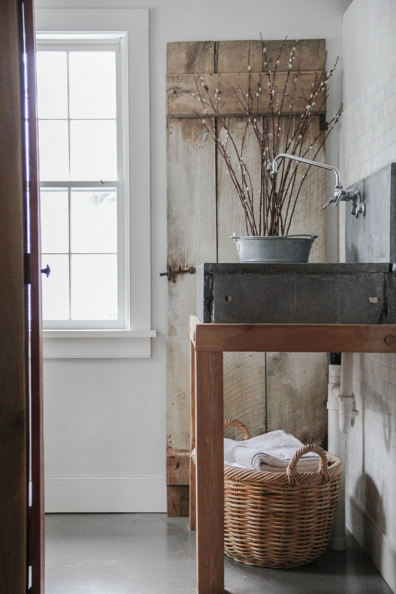 Soapstone sink and whitewashed door salvaged from the original home