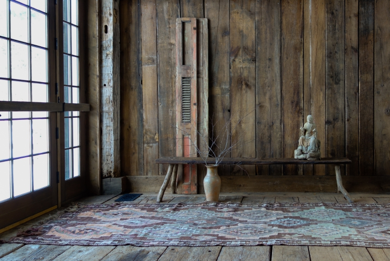 A handmade bench and reclaimed shutters in the restored Riverledge barn
